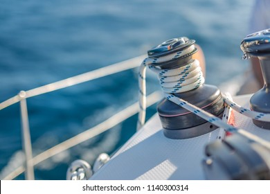 Sailing background concept. Knots and winch and sea closeup view. Sea and ocean sport or recreational design template