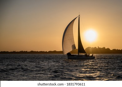 Sailing boat against the evening sun
