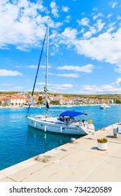 Sailing boat anchoring in Primosten port, Dalmatia, Croatia