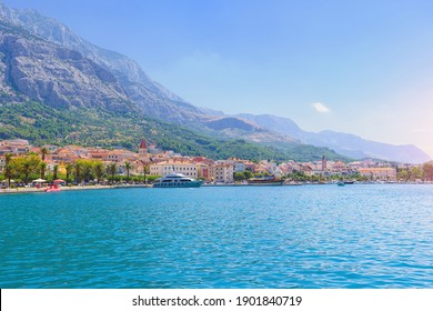 Sailing boat anchoring in Baška Voda town with historic buildin - Shutterstock ID 1901840719