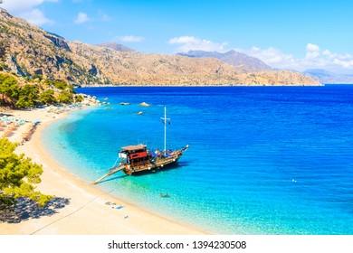 Sailing boat in beautiful bay at Apella beach, Karpathos island, Greece