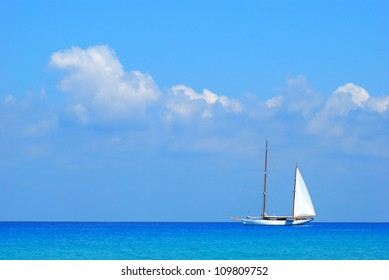 Sailing boat and calm sea