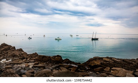 Sailing boat in the clear water near Cancale, Brittany, France