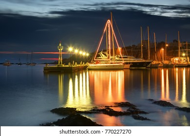 Sailing boat decorated and illuminated for christmas, syros island, Greece