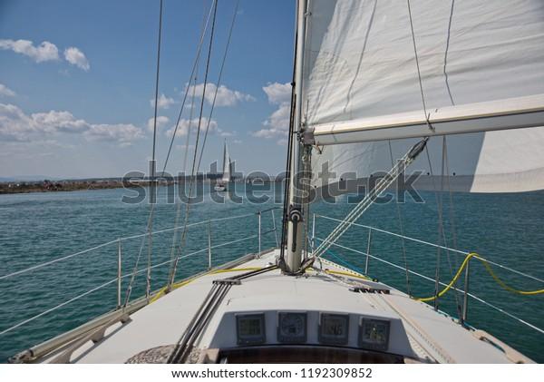 sailing boat entering port