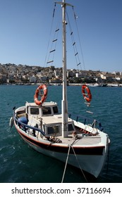 Sailing boat at the island of Crete with the background of Sitia