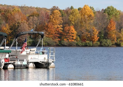 Sailing boat in the lake in autumn