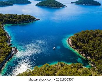 sailing boat in a lonsome bay in croatia