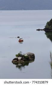 sailing boat near an island