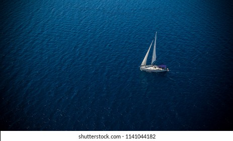 Sailing boat on open water, aerial view. Active life style, water transportation and marine sport.