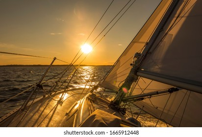 Sailing boat on the sunset