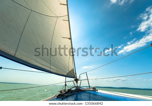 Sailing boat on the water in sunshine