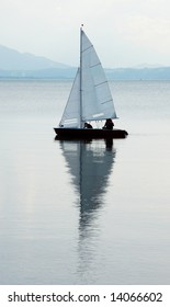 Sailing boat with reflection