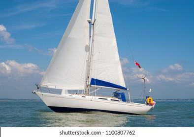 Sailing boat, sail boat or yacht at sea with white sails