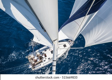 Sailing boat with spinnaker from top of the mast