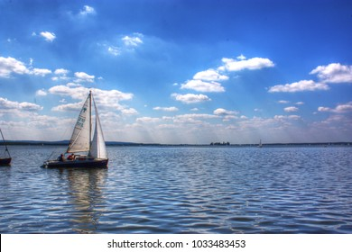 A sailing boat is taking off from the sea near Hannover in germany