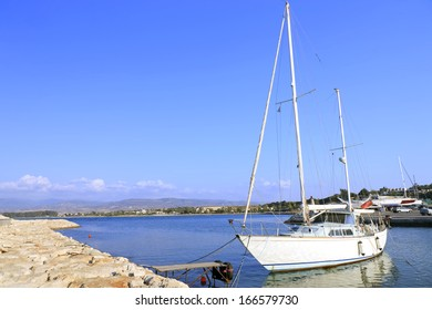 Sailing boat tied on a wooden jetty