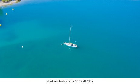 sailing boat in the turquoise sea