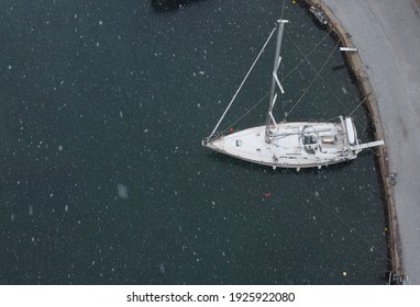 Sailing boat under the snow