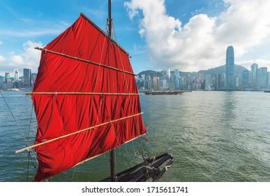 Sailing boat in Victoria Harbor of Hong Kong city