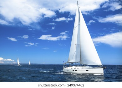 Sailing boat yacht or sail regatta race on blue water Sea.