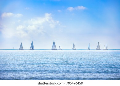 Sailing boat yacht or sailboat group regatta race on sea or ocean water. Panoramic view.