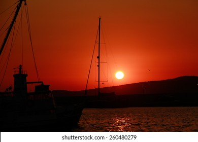 Sailing boat / Yacht in the sea at sunset. Egg Yolk.