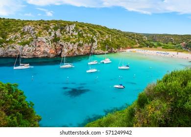 Sailing boats in beautiful bay of Cala Porter on Menorca island, Spain