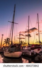 Sailing boats docked at the Ala Wai Harbor at sunset. Ala Wai Yacht Harbor is the largest yacht harbor of Hawaii, situated between Waikiki and downtown Honolulu in Oahu, Hawaii.