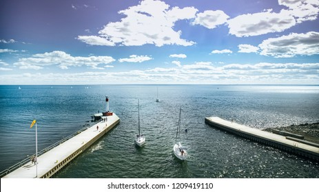 Sailing boats entering marina in Oakville, Ontario Canada