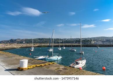 Sailing boats in the harbor of Howth Peninsula near Dublin.