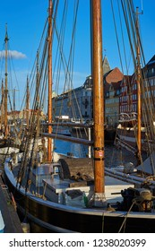 Sailing boats in Nyhavn canal in Copenhagen in sunny day. Nyhavn is a 17th century waterfront, canal and entertainment district. It was constructed by King Christian V.