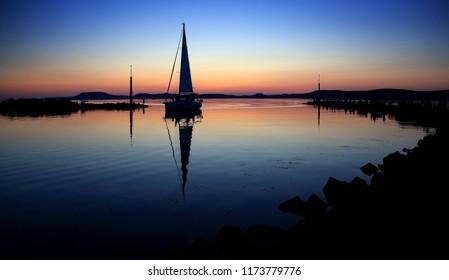 Sailing boats on Lake Balaton at sunset