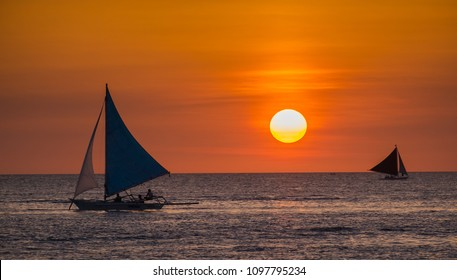 Sailing boats on the sea at the sunset at Boracay island,Philippines