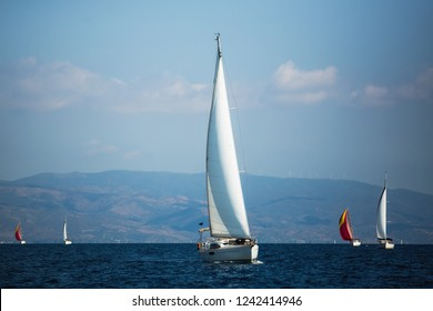 Sailing boats participate in sail yacht regatta in Aegean Sea, Greece.
