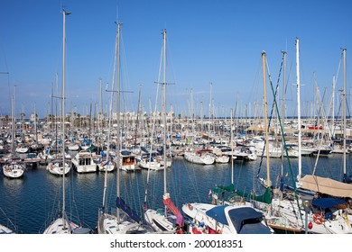 Sailing boats in Port Olimpic marina in the city of Barcelona, Catalonia, Spain.