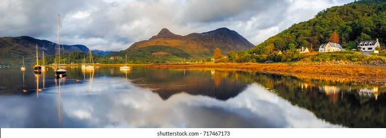 Sailing boats with reflections on Loch Leven, panorama from Glencoe, Scotland.