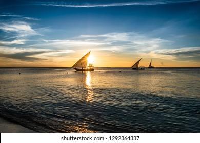 Sailing boats at sunset in Zanzibar, Nungwi beach, Tanzania, Africa