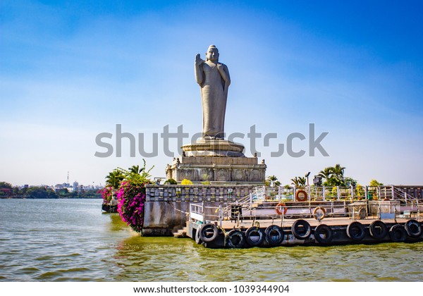 Sailing by the Giant Buddha Statue with Bright Pink Bougainvillea Plants in the Middle of Hussain Sagar Lake in Hyderabad, India