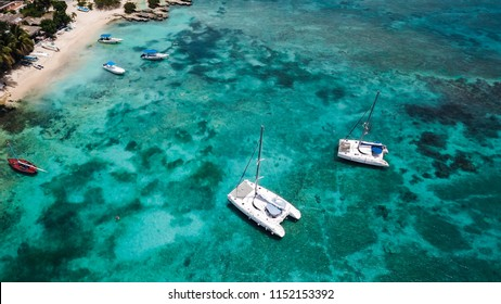 Sailing catamaran. Yachts and boats in the bay. Beautiful bay with turquoise water. View from above