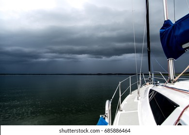 Sailing concept with boat and lake water storm weather