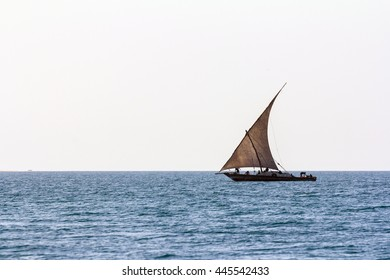 a sailing dhow used for fishing offshore around zanzibar island on the blue open ocean