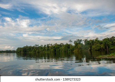 Sailing down river amidst the Amazon Jungle. Amazon river, Manaus, Amazonas, Brazil.