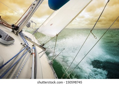 Sailing fast on port tacks with water splashing on deck