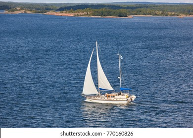 Sailing in Finland coastline. Aland archipelago. Finnish summer sport. Outdoor