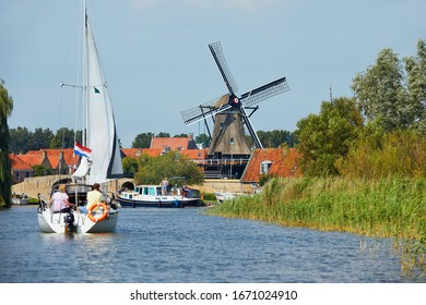 Sailing to the fortress town of 'Sloten' with the windmill from the year of 1755 in the province of Friesland, the Netherlands
