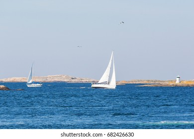 Sailing into rocky archipelago in summer