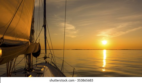 Sailing into the sunset. Yachting