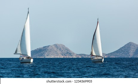 Sailing luxury boats participate in sail yacht regatta in the Aegean Sea in Greece.