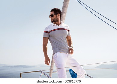 Sailing man on boat in ocean